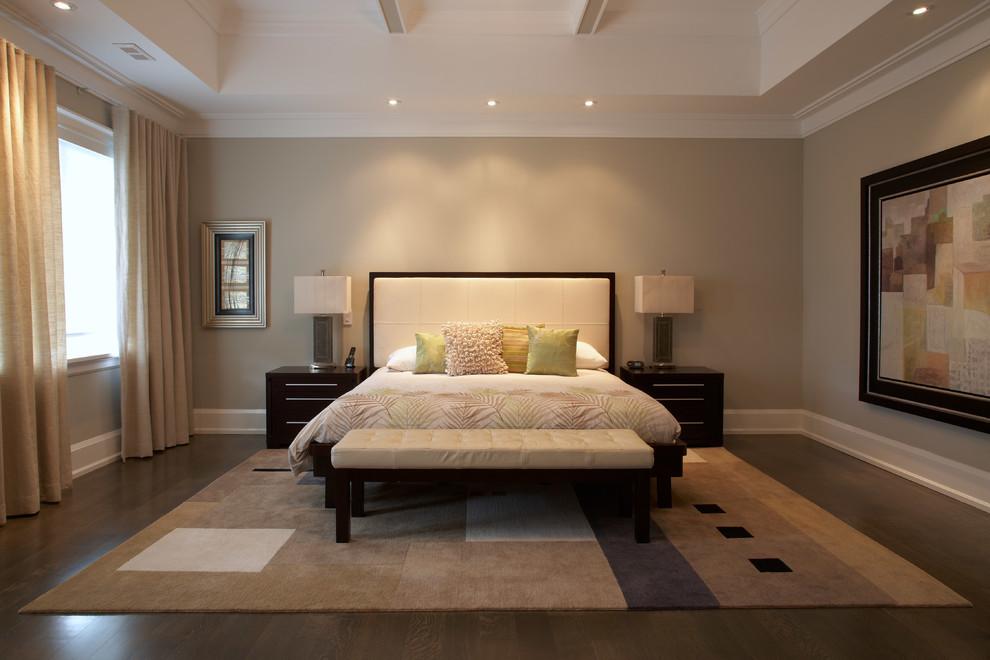 Trendy master dark wood floor and brown floor bedroom photo in Toronto with beige walls
