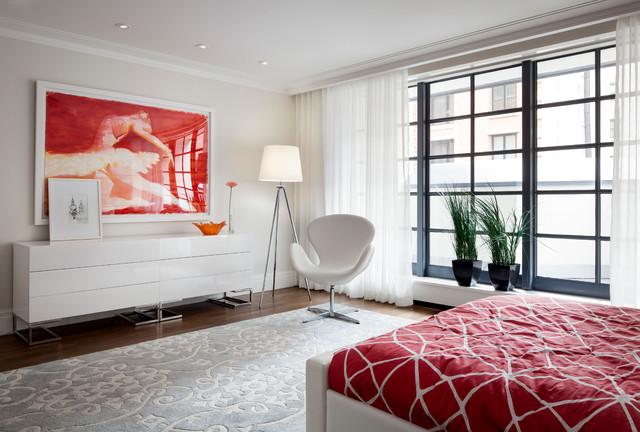 Trendy dark wood floor bedroom photo in New York with beige walls