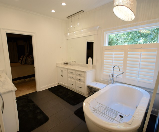 Inspiration for a contemporary ceramic floor bedroom remodel in Atlanta with white walls