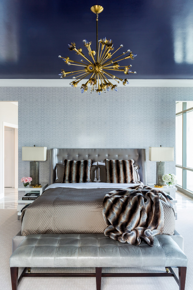 Example of a trendy master bedroom design in Little Rock with blue walls
