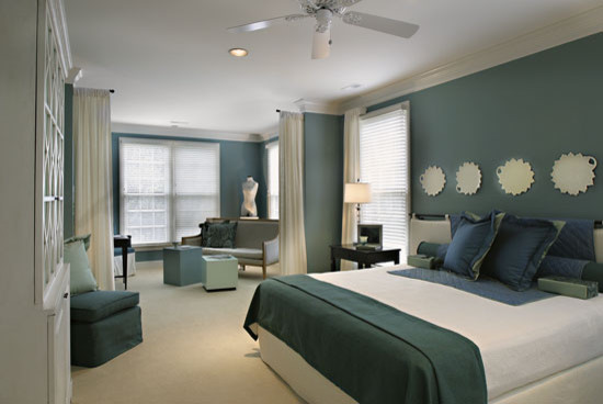 This is an example of a contemporary bedroom in Nashville with blue walls and carpet.