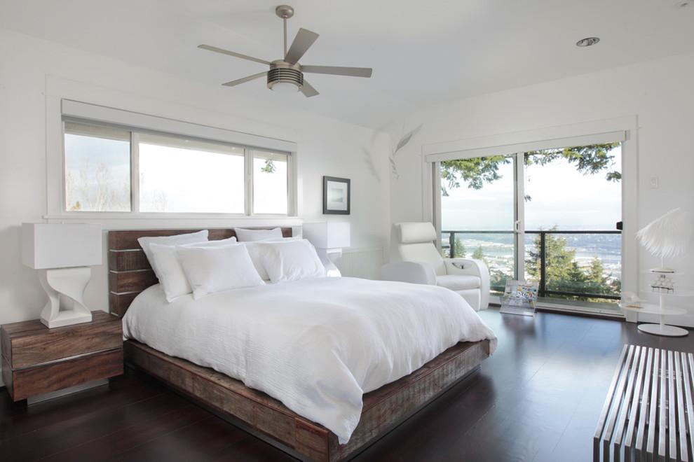 Example of a trendy dark wood floor bedroom design in Portland with white walls
