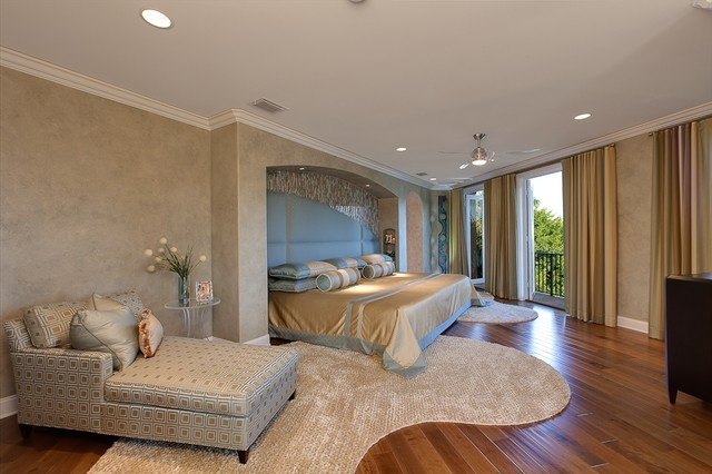 Inspiration for a contemporary medium tone wood floor bedroom remodel in Miami with beige walls
