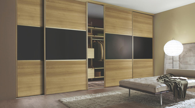 Contemporary walnut black sliding wardrobe doors for B q bedrooms fitted