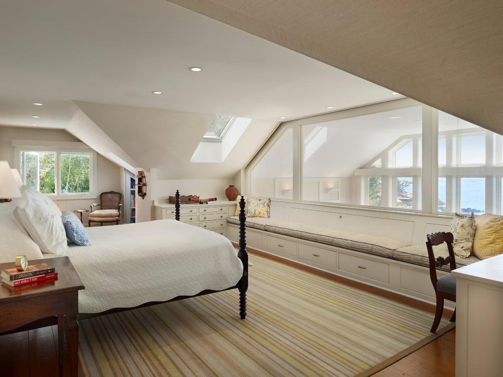 Coastal master medium tone wood floor bedroom photo in New York with white walls