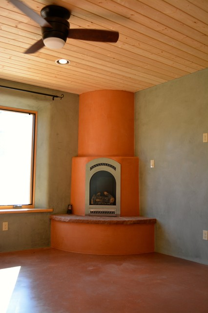 Corner Kiva Fireplace Southwestern Bedroom