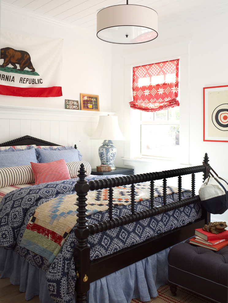 Inspiration for a mid-sized coastal guest light wood floor bedroom remodel in San Diego with white walls
