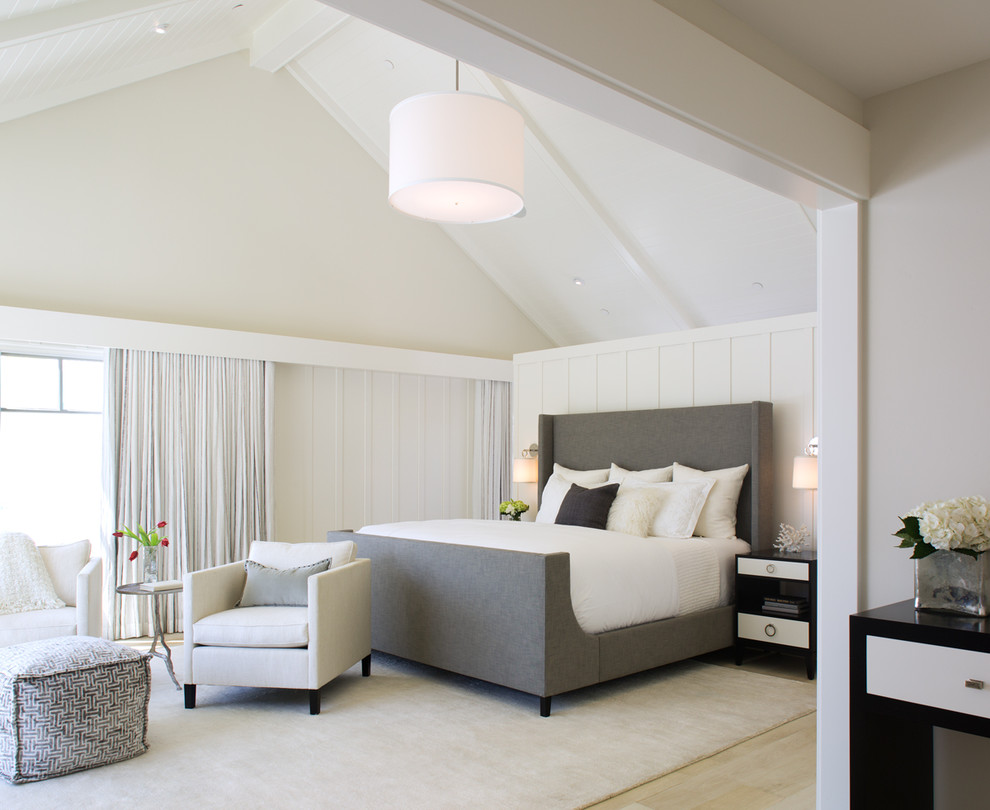 Transitional master light wood floor bedroom photo in San Diego with white walls
