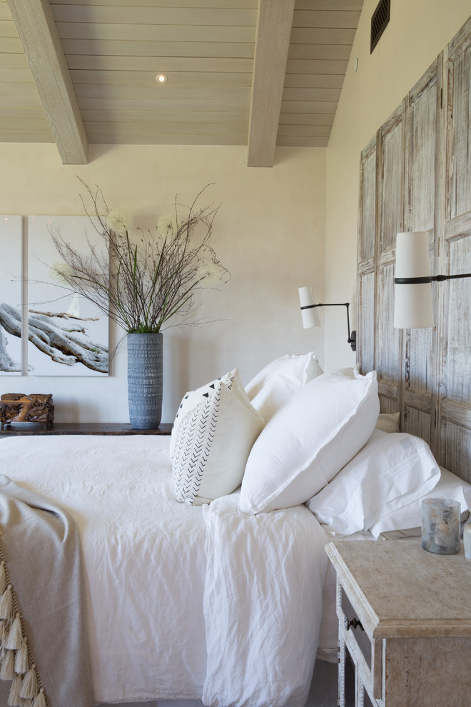 Inspiration for a mediterranean master light wood floor and beige floor bedroom remodel in Santa Barbara with white walls and no fireplace