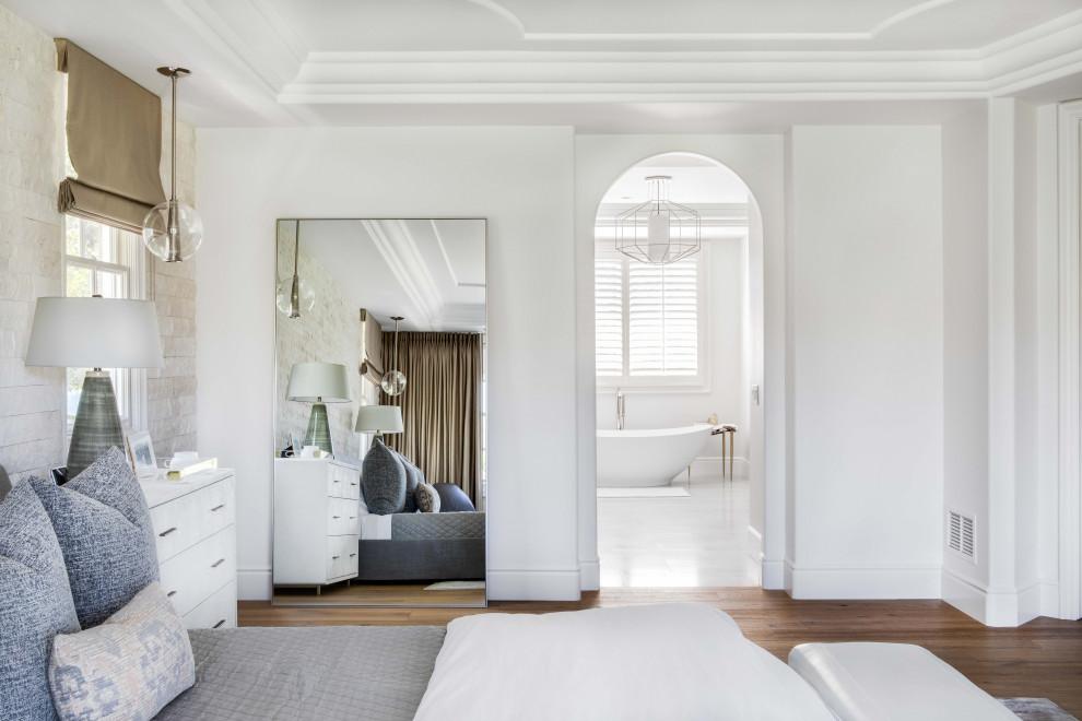 Inspiration for a master light wood floor bedroom remodel in Orange County