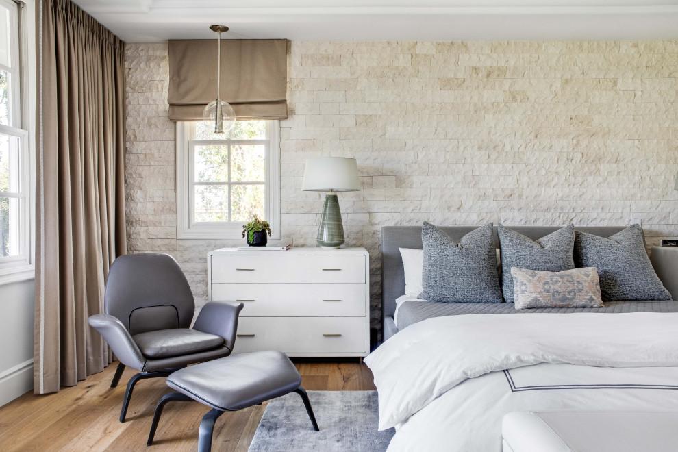 Master light wood floor bedroom photo in Orange County