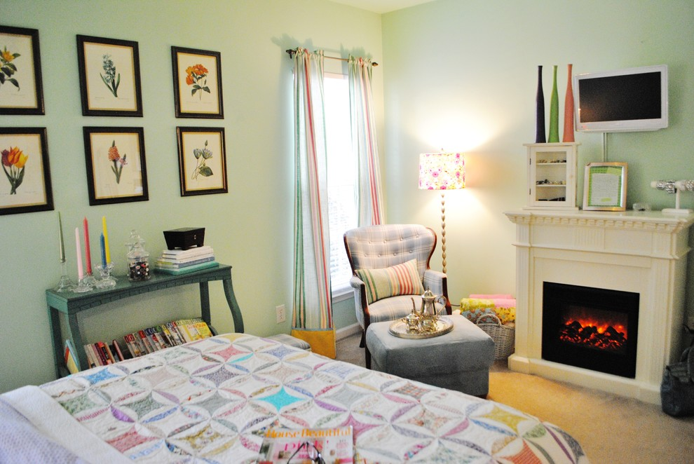 Bedroom - eclectic bedroom idea in Charlotte with a standard fireplace