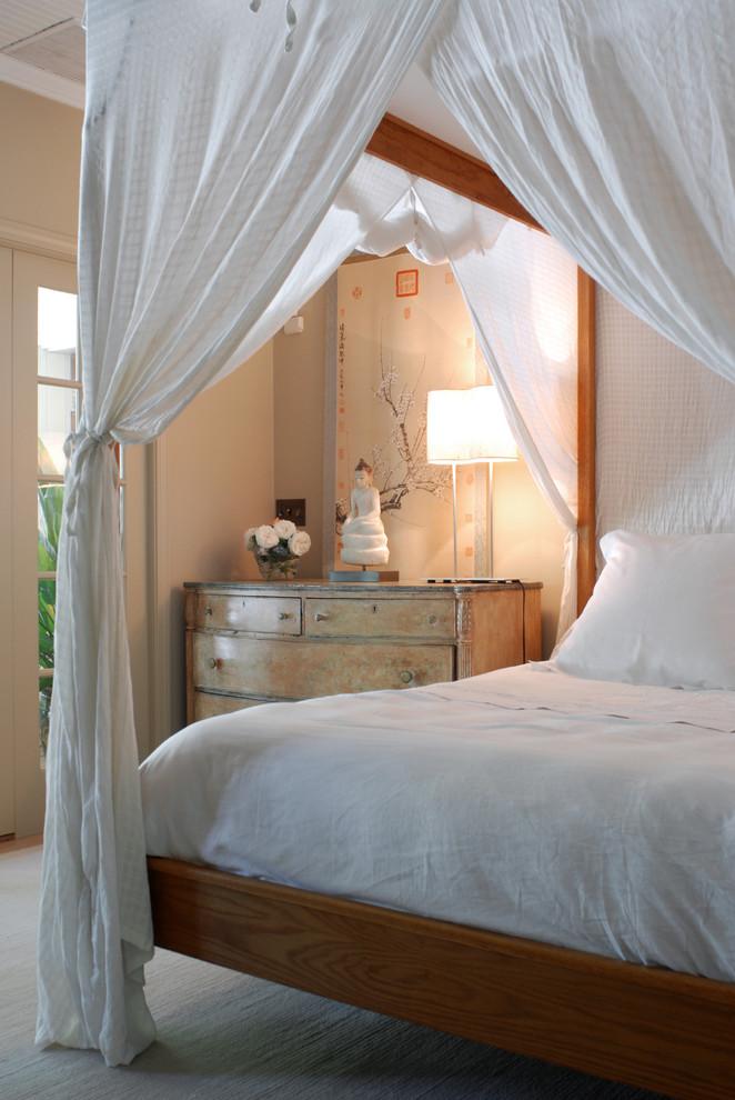 Eclectic bedroom photo in New York with beige walls