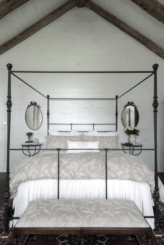 Example of a mid-sized farmhouse master dark wood floor bedroom design in Austin with white walls
