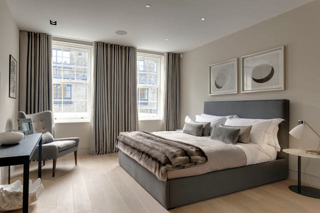 grey curtains for bedroom. Inspiration for a transitional light wood floor bedroom remodel in London  with beige walls Gray Curtains Houzz