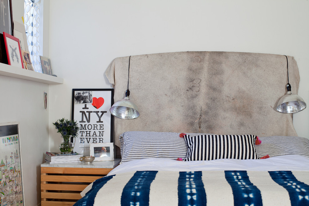 Example of an eclectic bedroom design with white walls