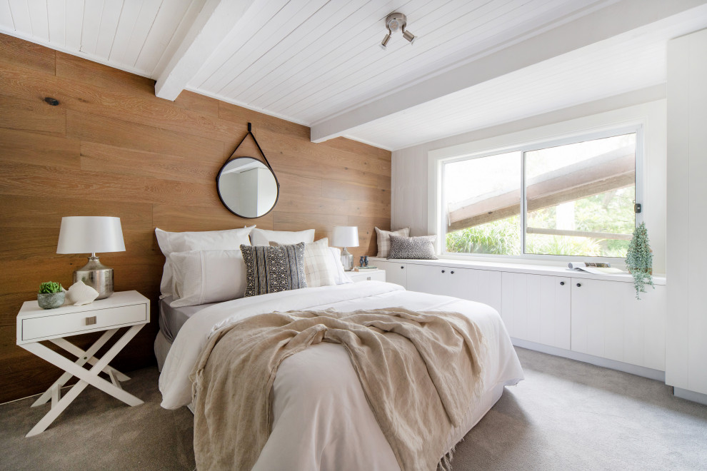 Design ideas for a transitional bedroom in Other with brown walls, carpet, grey floor and wood walls.