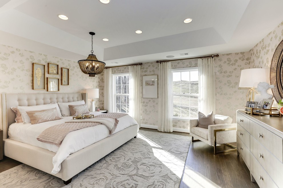 Inspiration for a transitional master medium tone wood floor and brown floor bedroom remodel in DC Metro with beige walls