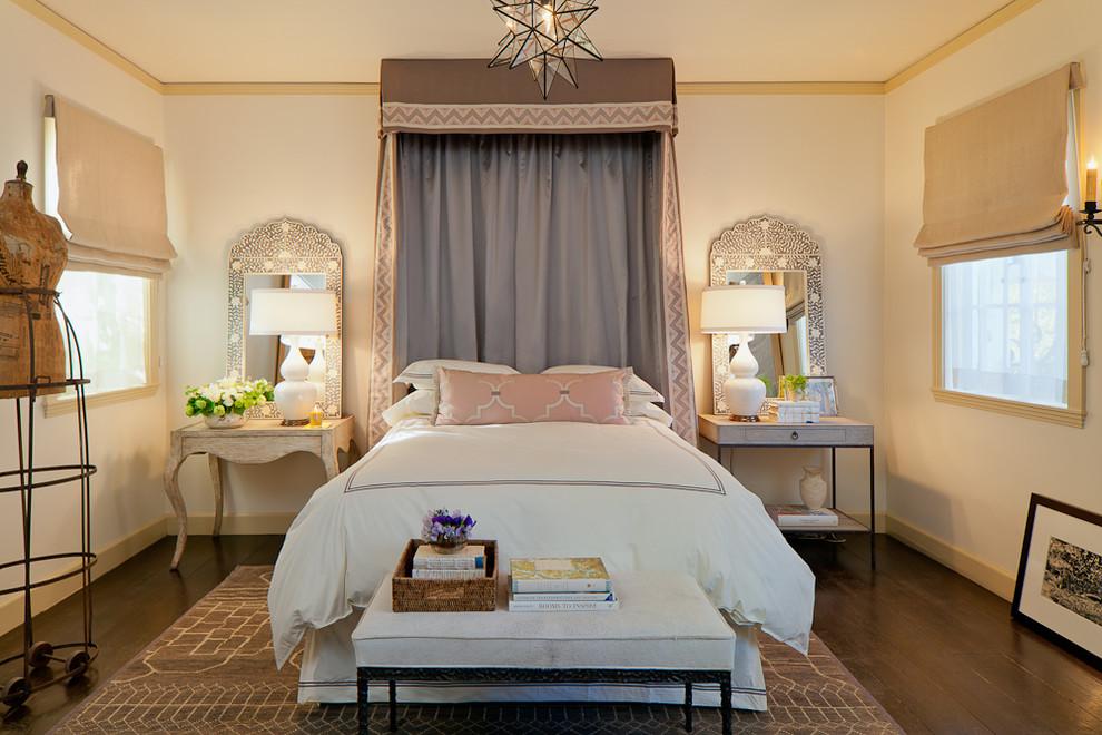 Bedroom - mediterranean dark wood floor and brown floor bedroom idea in San Francisco with beige walls