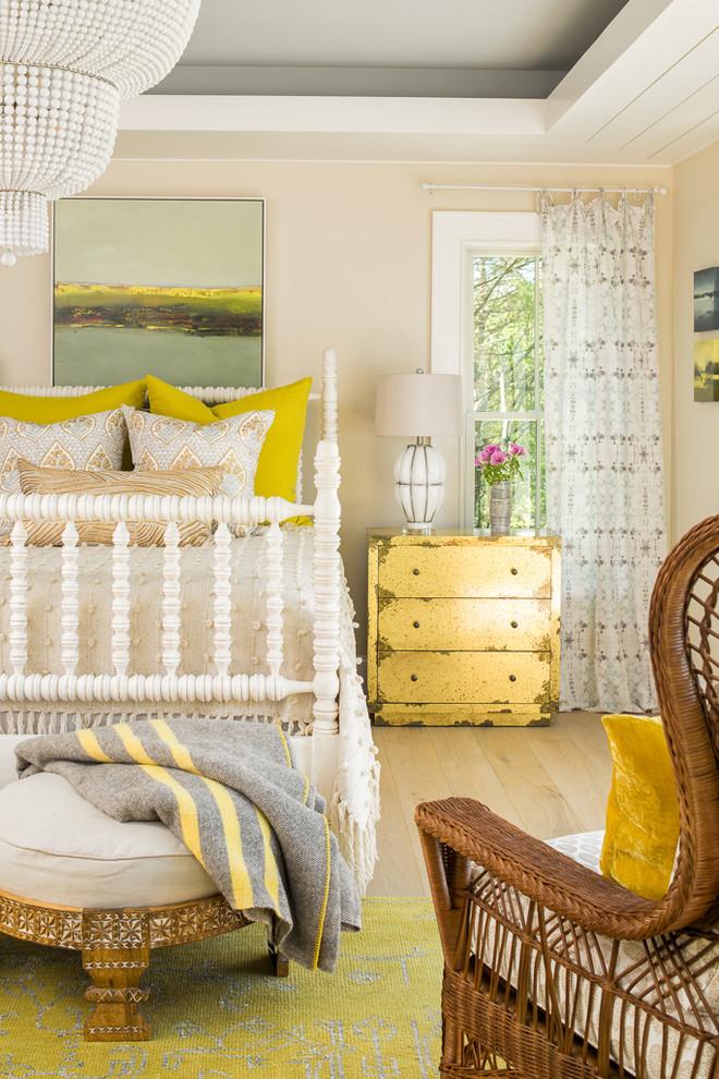 Beach style light wood floor and beige floor bedroom photo in Portland Maine with beige walls