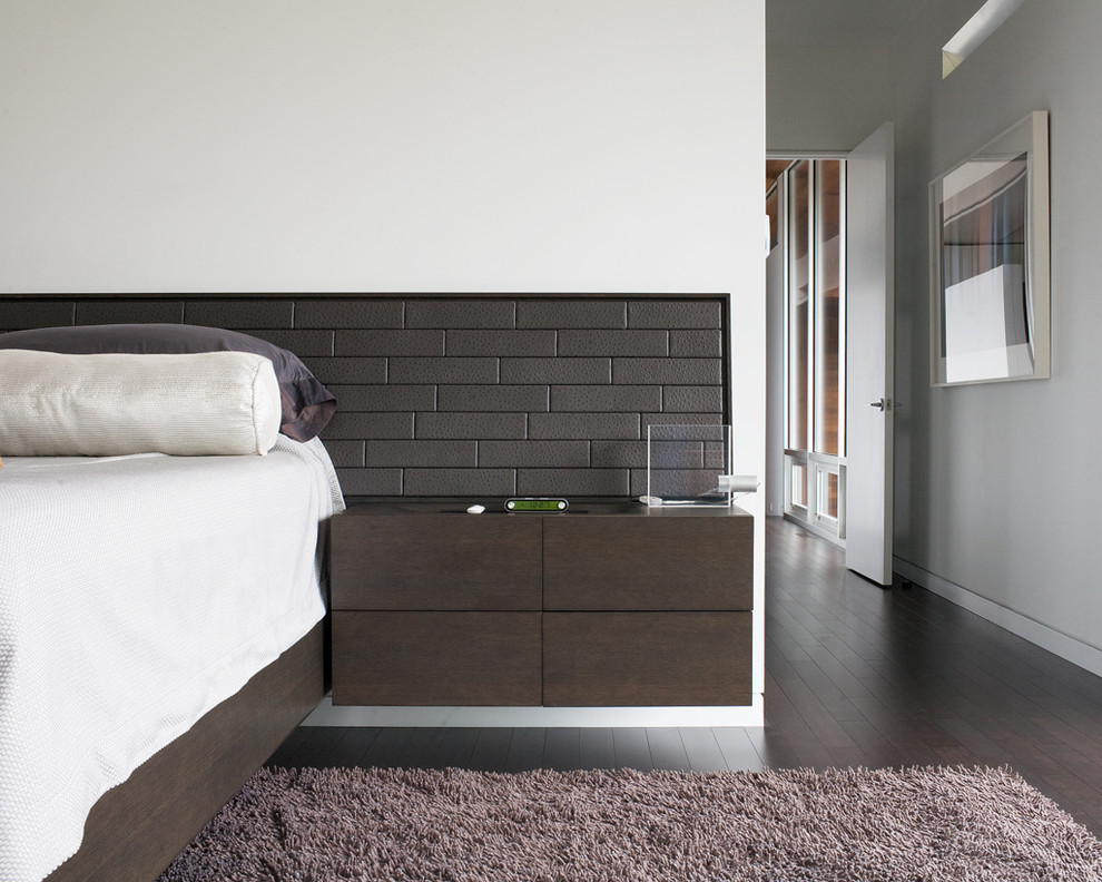 Inspiration for a contemporary bedroom in Kansas City with white walls and dark hardwood flooring.