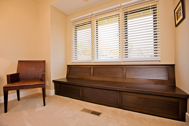 Custom Cabinetry Window Seat With Storage In Guest Bedroom