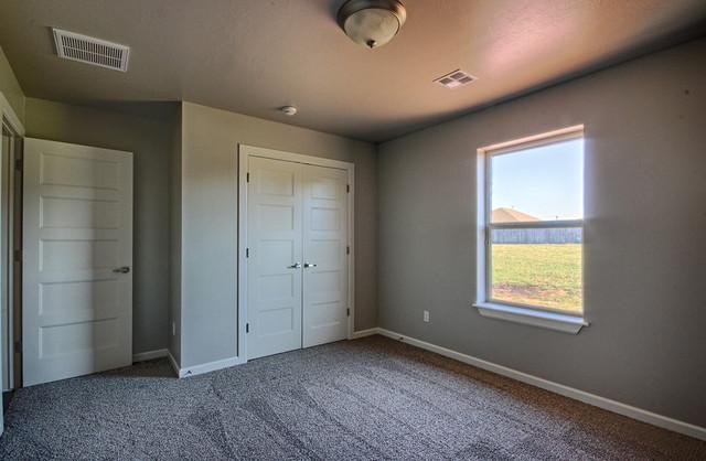 Custom Home in Edmond contemporary-bedroom