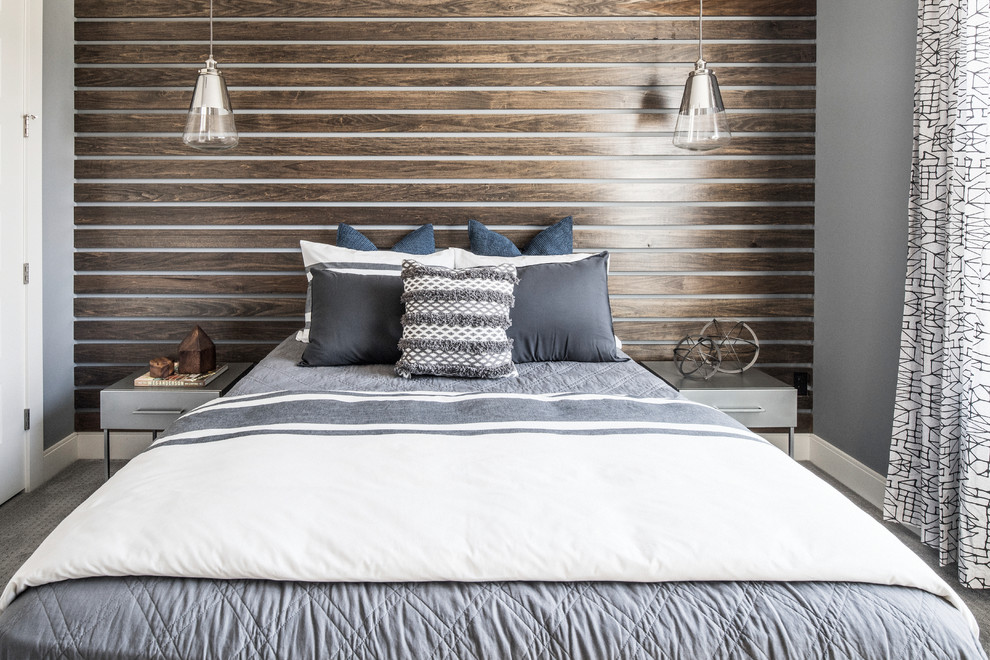 Design ideas for a transitional bedroom in Orlando with carpet, grey floor and brown walls.