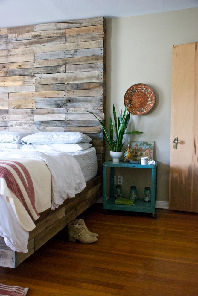 Eclectic medium tone wood floor bedroom photo in Dallas with gray walls