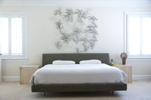 metal sculpture pieces above the bed. Black Bedroom Furniture Sets. Home Design Ideas