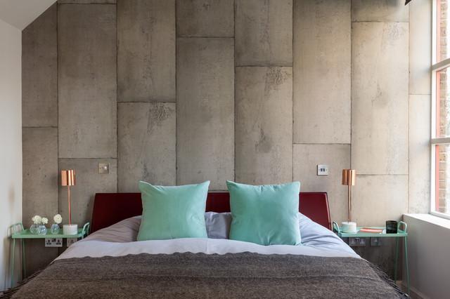 Urban master bedroom photo in London