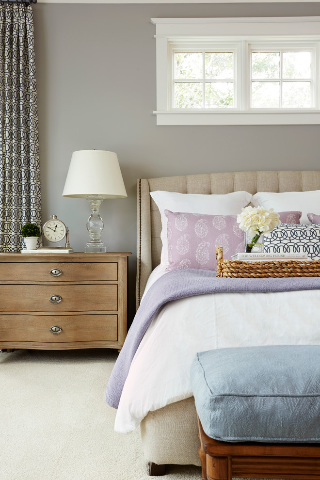 Example of a classic carpeted bedroom design in Minneapolis with gray walls