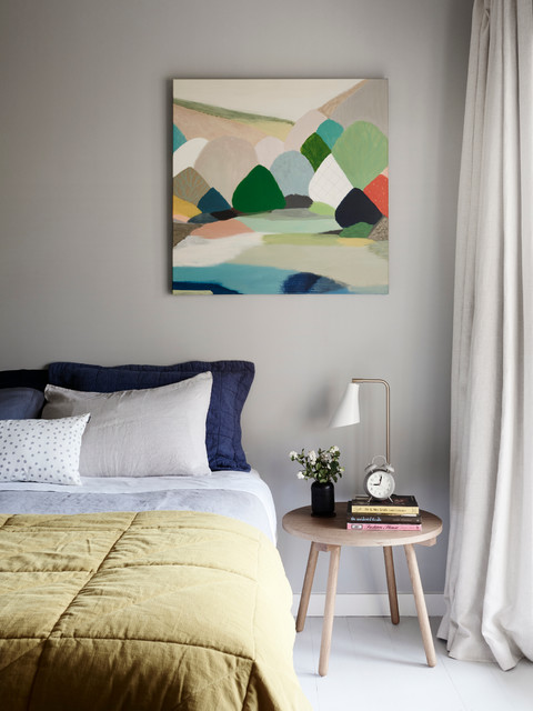 Example of a mid-sized danish light wood floor bedroom design in Melbourne with gray walls