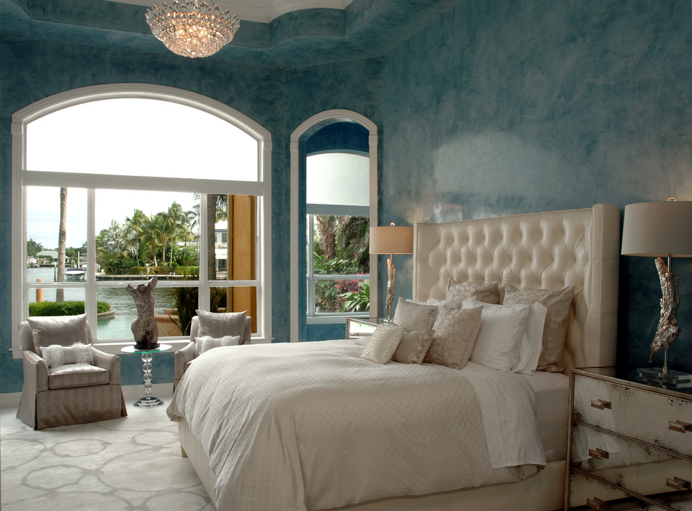 Large transitional master carpeted bedroom photo in Miami with blue walls
