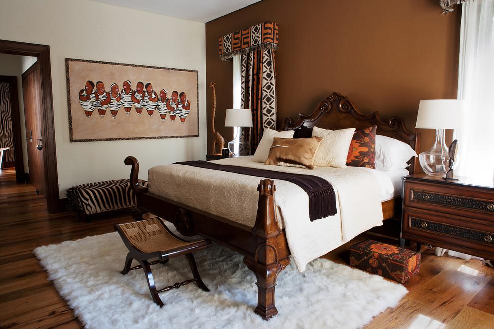 Example of a trendy medium tone wood floor bedroom design in Denver with brown walls