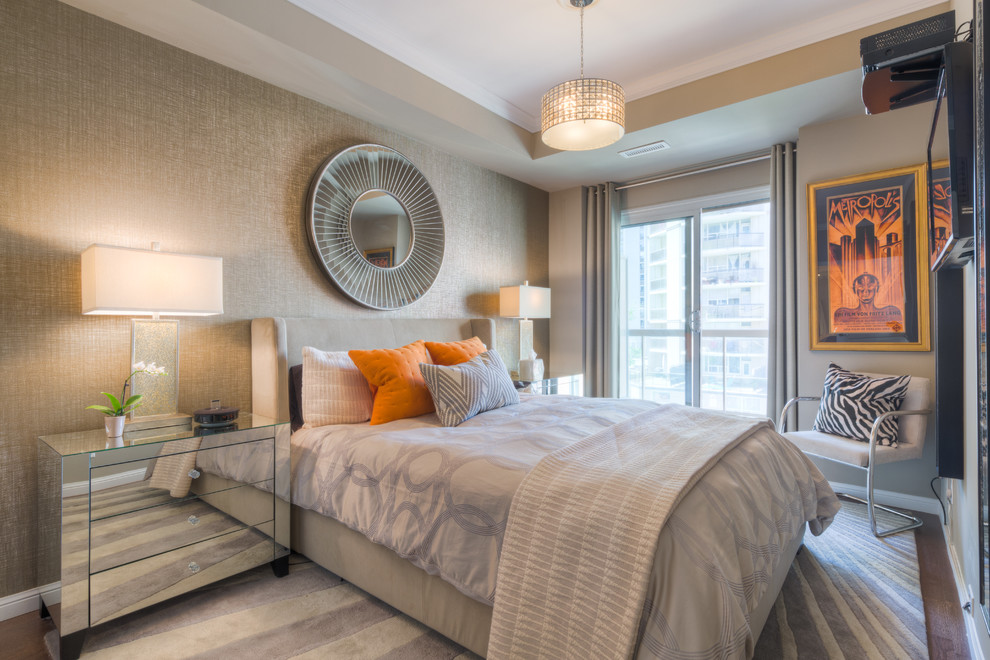 Example of a mid-sized trendy master medium tone wood floor bedroom design in Toronto with gray walls