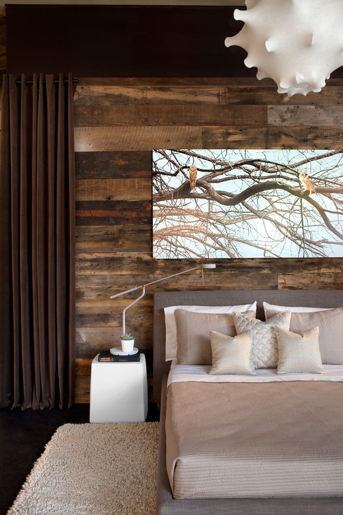 reclaimed wood used as a rustic backdrop for modern furnishings wwwsettingforfourcom