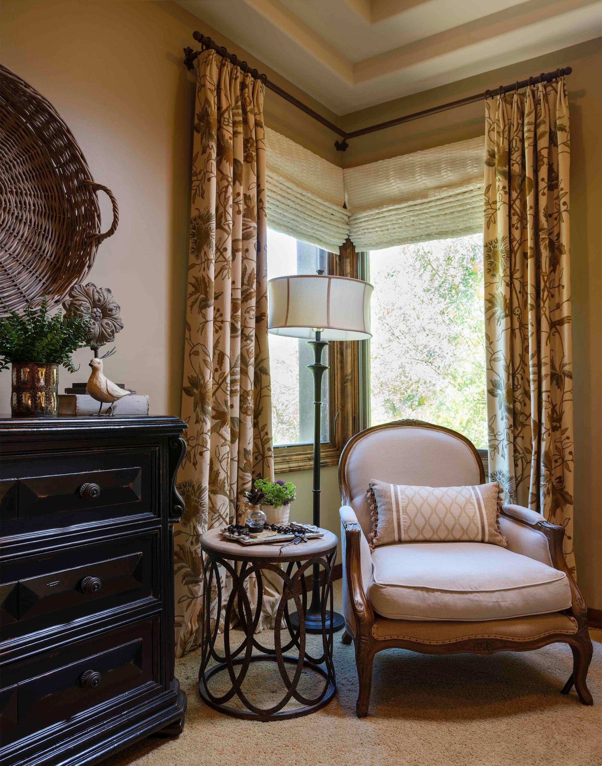 Example of a tuscan bedroom design in Phoenix