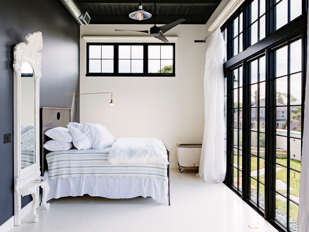 Bedroom - industrial guest white floor bedroom idea in Portland with blue walls and no fireplace