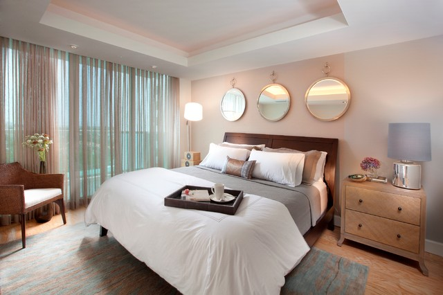 Example Of A Trendy Bedroom Design In Miami With Beige Walls