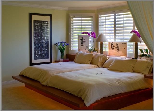 Double queen beds for an old married couple contemporary-bedroom