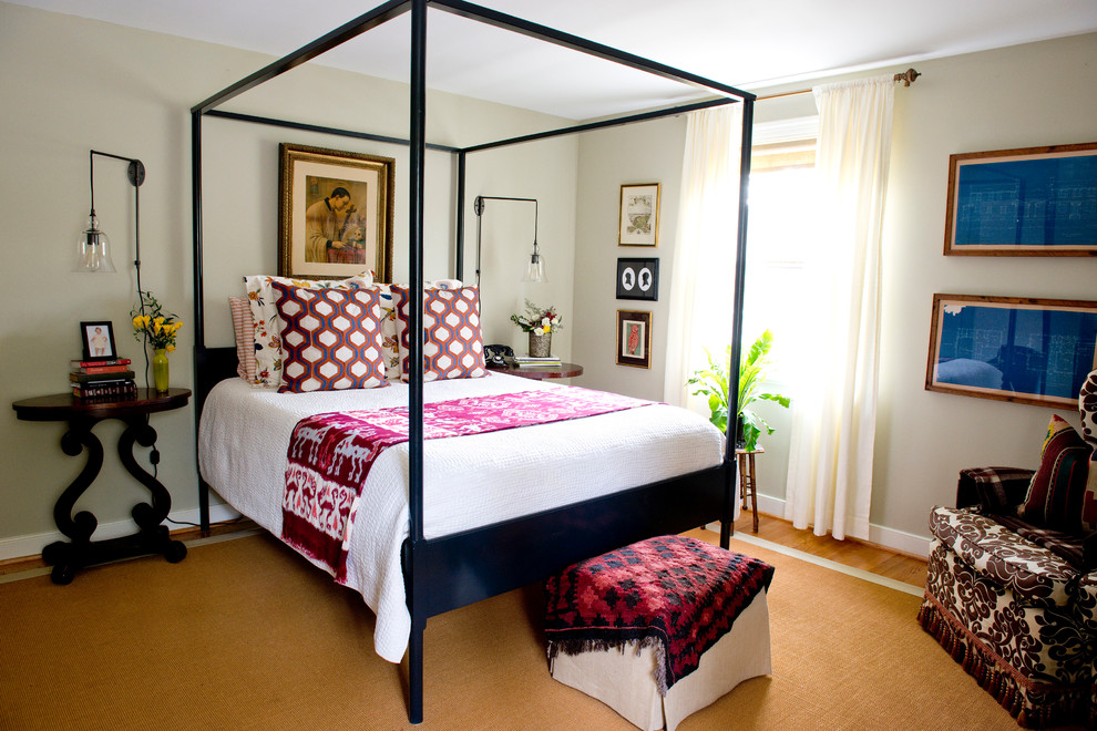 Mid-sized eclectic master medium tone wood floor bedroom photo in Richmond with beige walls