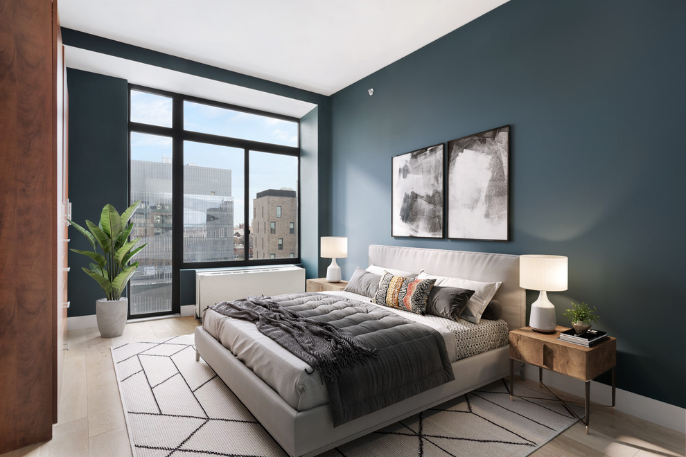 Example of a mid-sized trendy master light wood floor and brown floor bedroom design in New York with black walls and no fireplace