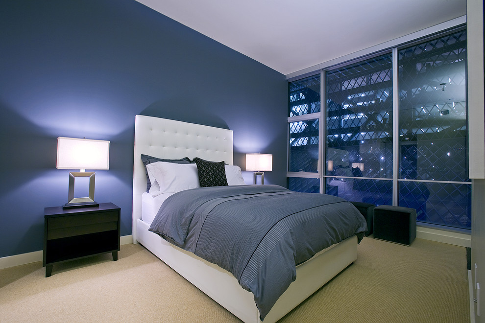 Example of a trendy bedroom design in Seattle with blue walls