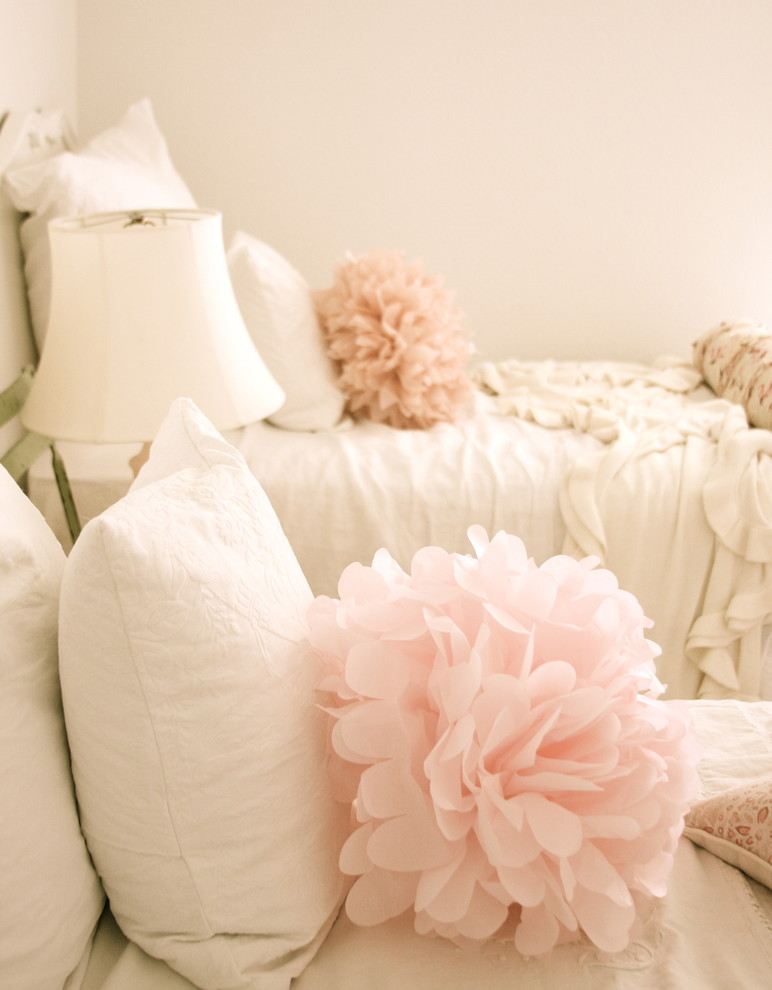 Example of a cottage chic bedroom design in Other with white walls