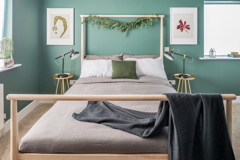 Example of a mid-sized danish carpeted and beige floor bedroom design in Dublin with green walls and no fireplace