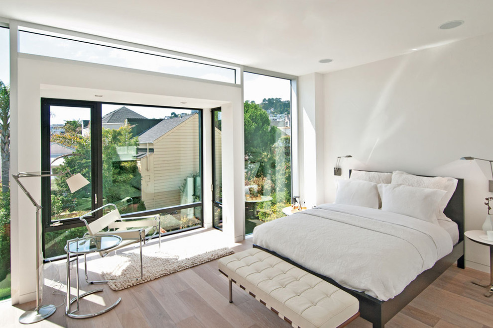 Minimalist bedroom photo in San Francisco with white walls