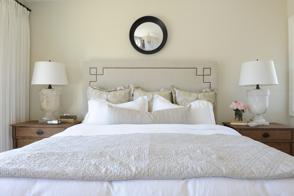 Inspiration for a timeless bedroom remodel in Vancouver with beige walls