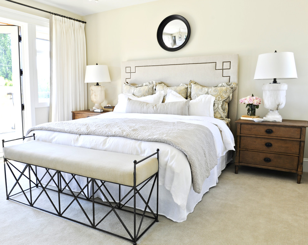 Inspiration for a timeless carpeted and green floor bedroom remodel in Vancouver with beige walls