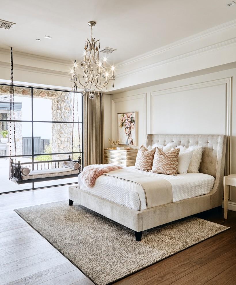 Example of a transitional dark wood floor and brown floor bedroom design in Phoenix with beige walls